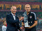 Arjen Robben of Bayern Munich receives the MVP trophy from Dominique Boesch, Chief of the Audi sales division at FAW Wolkswagen, at the end of a friendly match against VfL Wolfsburg as part of the Audi Football Summit 2012 on July 26, 2012 at the Guangdong Olympic Sports Center in Guangzhou, China. Photo by Victor Fraile / The Power of Sport Images