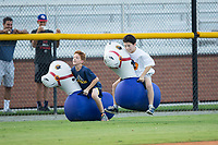 Two young fans compete in a bouncy horse race between innings of the Appalachian League game between the Danville Braves and the Burlington Royals at Burlington Athletic Stadium on August 15, 2017 in Burlington, North Carolina.  The Royals defeated the Braves 6-2.  (Brian Westerholt/Four Seam Images)