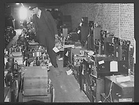 In the municipal warehouse<br />  in Amsterdam there are thousands of radio sets which were then claimed by the Germans and which are now returned to their rightful owners. Date: 1945