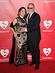 Gloria Estefan and Emilio Estefan attends The 2014 MusiCares Person of the Year Dinner honoring Carole King at the Los Angeles Convention Center, West Hall  in Los Angeles, California on January 24,2014                                                                               © 2014 Hollywood Press Agency