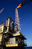 Rio de Janeiro, Brazil. Petrobras oil rig flaring off gas with blue sky, Campos Basin oil field.