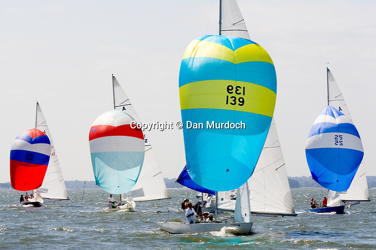Four sailboats with full spinnakers