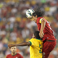 Portugal defender Bruno Alves (2) heads the ball.  In an international friendly, Brazil (yellow/blue) defeated Portugal (red), 3-1, at Gillette Stadium on September 10, 2013.