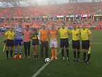 A Sharpstown soccer player meets members of Houston Dynamo before a game.