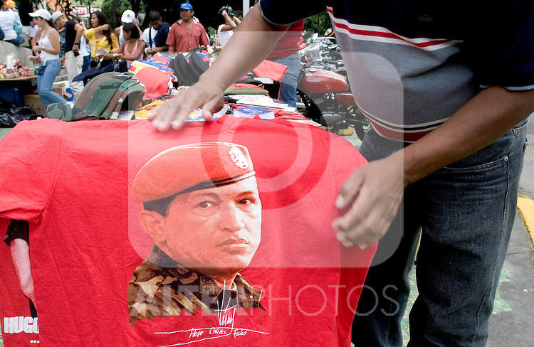 Paraphernalia with Venezuelan President Hugo Chavez face is sold after a military parade in Caracas, Venezuela, on Wednesday, Jul. 05, 2006. The military parade was to celebrate the 195th anniversary of the Venezuelan Independence from Spain. (ALTERPHOTOS/Alvaro Hernandez)