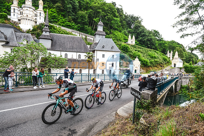 The first breakaway of the day with Matej Mohoric (SLO) Bahrain Victorious, Sean Bennett (USA) Qhubeka NextHash and Chris Juul-Jensen (IRL/DEN) Team Bike Echange pass the sanctuary of Betharram during Stage 18 of the 2021 Tour de France, running 129.7km from Pau to Luz Ardiden, France. 15th July 2021.  <br /> Picture: A.S.O./Charly Lopez | Cyclefile<br /> <br /> All photos usage must carry mandatory copyright credit (© Cyclefile | A.S.O./Charly Lopez)