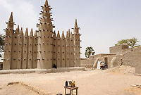 MALI, Mopti, mosque built from clay, fuel bottle for sale