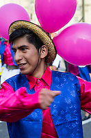 Lima, Peru.  Young Peruvian Man Marching in an Andean Cultural Parade, Plaza de Armas.