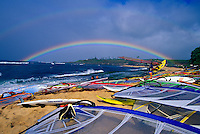 A rainbow over windsurfing rigs at Hookipa Beach Park, which is just outside the town of Paia along the Hana Highway. It is Maui's best and most popular beach park for surfing and windsurfing. Hookipa means hospitality in Hawaiian.
