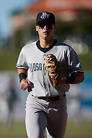 Hudson Valley Renegades shortstop Anthony Volpe (5) jogs off the field between innings of the game against the Greensboro Grasshoppers at First National Bank Field on September 2, 2021 in Greensboro, North Carolina. (Brian Westerholt/Four Seam Images)