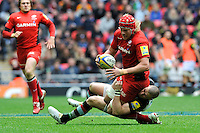 Mouritz Botha of Saracens is tackled by Mike Brown of Harlequins during the Aviva Premiership match between Saracens and Harlequins at Wembley Stadium on Saturday 31st March 2012 (Photo by Rob Munro)