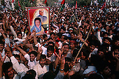 Gujranwala-Punjab, Pakistan<br /> November 12, 1988<br /> <br /> Crowds greet Benazir Bhutto as she arrives at a massive campaign rally in the Punjab province.<br /> <br /> Benazir Bhutto is the eldest child of former Pakistan President and Prime Minister Zulfikar Ali Bhutto. She found herself placed under house arrest in the wake of her father's imprisonment and subsequent execution in 1979. In 1984 she became the leader in exile of the Pakistan Peoples Party (PPP), her father's party, though she was unable to make her political presence felt in Pakistan until after the death of General Muhammad Zia-ul-Haq. <br /> <br /> On 16 November 1988 Benazir's PPP won the largest bloc of seats in the National Assembly. Bhutto was sworn in as Prime Minister in December, at age 35 she became the first woman to head the government of a Muslim-majority state in modern times. <br /> <br /> She was removed from office 20 months later under orders of then-president Ghulam Ishaq Khan for alleged corruption. Bhutto was re-elected in 1993 but was again removed by President Farooq Leghari in 1996, on similar charges. Bhutto went into self-imposed exile in Dubai in 1998, until she returned to Pakistan on October 2007, after General Musharraf granted her amnesty and all corruption charges withdrawn.