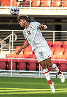 WASHINGTON, DC - SEPTEMBER 6: Maryland defender Brett St. Martin (12) heads clear during a game between University of Virginia and University of Maryland at Audi Field on September 6, 2021 in Washington, DC.