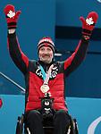Jaime Anseeuw, PyeongChang 2018 - Wheelchair Curling // Curling en fauteuil roulant.<br /> Jaime Anseeuw receives the bronze medal // Jaime Anseeuw reçoit la médaille de bronze. 17/03/2018.