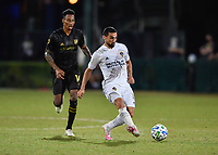 LAKE BUENA VISTA, FL - JULY 18: Sebastian Lletget #17 of LA Galaxy passes the ball away from Mark-Anthony Kaye #14 of LAFC during a game between Los Angeles Galaxy and Los Angeles FC at ESPN Wide World of Sports on July 18, 2020 in Lake Buena Vista, Florida.
