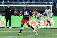 FOXBOROUGH, MA - NOVEMBER 20: Amar Sejdic #14 of Montreal Impact passes the ball as Teal Bunbury #10 of New England Revolution defends during the Audi 2020 MLS Cup Playoffs, Eastern Conference Play-In Round game between Montreal Impact and New England Revolution at Gillette Stadium on November 20, 2020 in Foxborough, Massachusetts.