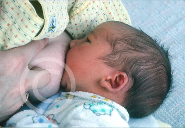 newborn baby boy 1 week old fed nursing closeup breastfeeding horizontal caucasian