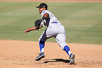 Surprise Saguaros second baseman Christian Colon #9 during an Arizona Fall League game against the Phoenix Desert Dogs at Phoenix Municipal Stadium on October 29, 2011 in Phoenix, Arizona.  Surprise defeated Surprise 11-0.  (Mike Janes/Four Seam Images)