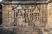 Borobudur, Java, Indonesia.  Stone Carving Showing Scenes from the Buddha's Life, North Face.