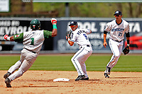 West Michigan Michigan Whitecaps second baseman Anthony Pereira (9) turns a double play as Fort Wayne TinCaps baserunner Eguy Rosario (1) arrives at second base during the Midwest League baseball game on April 26, 2017 at Fifth Third Ballpark in Comstock Park, Michigan. West Michigan defeated Fort Wayne 8-2. (Andrew Woolley/Four Seam Images via AP Images)