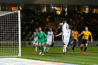 Alex Kenyon of Morecambe heads the ball clear as the Morecambe goal comes under pressure during the Sky Bet League Two match between Newport County and Morcambe at Rodney Parade, Newport, Wales, UK. 23 January 2018