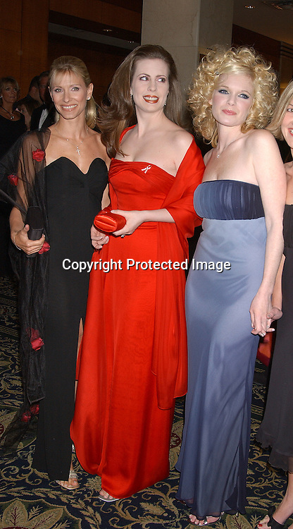 Kelley Menighan & Martha Byrne & Maura West                    ..arriving at the Emmy Awards dinner at the Sheraton in ..New York City on May 16,2003 ...Photo by Robin Platzer, Twin Images