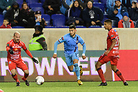HARRISON, NJ - FEBRUARY 26: Valentin Castellanos #11 of NYCFC is defended by Esteban Ramirez Segnini #5 and Randy Chirino #20 of AD San Carlos during a game between AD San Carlos and NYCFC at Red Bull on February 26, 2020 in Harrison, New Jersey.