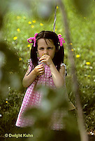 FA01-044z  Child smelling flower