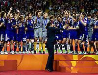 Japanese Team, Azusa Iwashimizu, Ayumi Kaihori, Steffi Jones, trophy.  Japan won the FIFA Women's World Cup on penalty kicks after tying the United States, 2-2, in extra time at FIFA Women's World Cup Stadium in Frankfurt Germany.