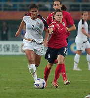 U.S. midfielder Shannon Boxx (7) pushes the ball into the attack. The United States (USA) defeated England (ENG) 3-0 during a quarter-final match of the FIFA Women's World Cup China 2007 at Tianjin Olympics Center Stadium in Tianjin, China, on September 22, 2007.