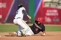 Tulane Green Wave shortstop Collin Burns (2) tags Brad Burckel (5) out at second on an attempted steal during a game against the Houston Cougars on May 25, 2021 at BayCare Ballpark in Clearwater, Florida.  Tulane defeated Houston 4-1 in the opening game of the American Athletic Conference Tournament.  (Mike Janes/Four Seam Images)