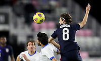 FORT LAUDERDALE, FL - DECEMBER 09: Brenden Aaronson #8 of the United States heads a ball during a game between El Salvador and USMNT at Inter Miami CF Stadium on December 09, 2020 in Fort Lauderdale, Florida.
