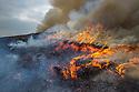 Controlled burning of heather moorland, Derwent Edge, Peak District National Park, Derbyshire, UK. October 2015.