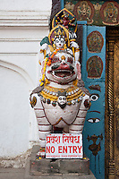 Kathmandu, Nepal.  A Stone Lion Ridden by Parvati, Wife of Shiva, Guards the Left Side of the Entrance to the Hanuman Dhoka, a Former Royal Palace, Durbar Square.