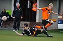 United's Gary MacKay Steven is stoped by Alloa's Ben Gordon.