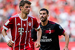 Bayern Munich Forward Thomas Muller (L) fights for position with AC Milan Midfielder Mateo Musacchio (R) during the 2017 International Champions Cup China  match between FC Bayern and AC Milan at Universiade Sports Centre Stadium on July 22, 2017 in Shenzhen, China. Photo by Marcio Rodrigo Machado / Power Sport Images