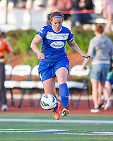 In a National Women's Soccer League Elite (NWSL) match, the Boston Breakers defeated the Western New York Flash  2-1, at Dilboy Stadium on May 5, 2013.  Boston Breakers defender Cat Whitehill (4) controls the ball.
