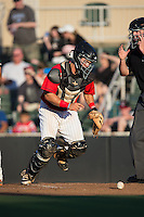 Kannapolis Intimidators catcher Brett Austin (20) chases after a wild pitch during the game against the Greensboro Grasshoppers at CMC-Northeast Stadium on August 1, 2015 in Kannapolis, North Carolina.  The Intimidators defeated the Grasshoppers 7-4.  (Brian Westerholt/Four Seam Images)