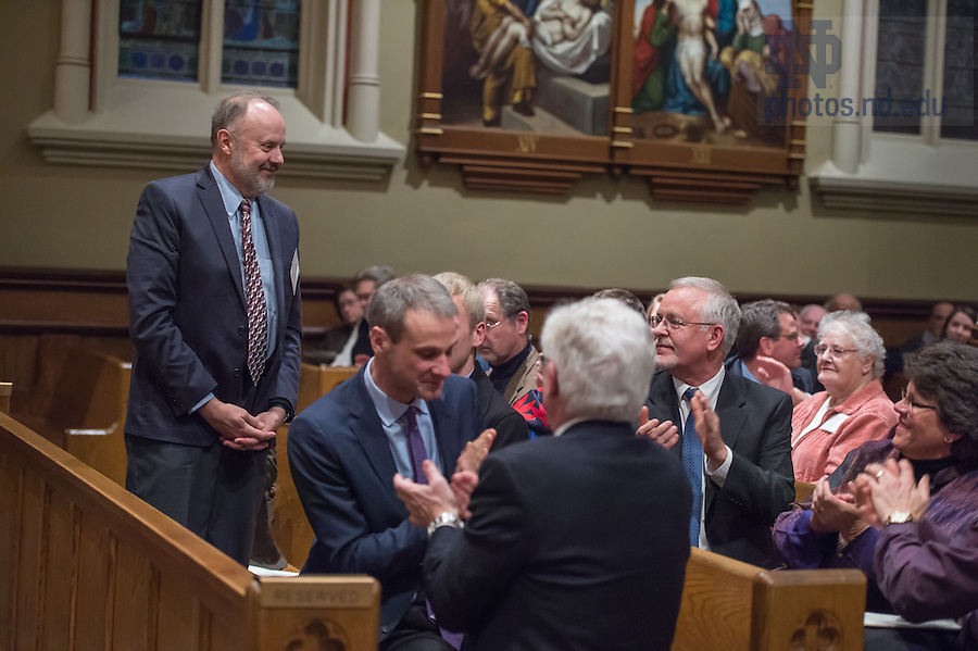 January 20, 2017; Organ builder Paul Fritts acknowledges the audience's applause at the close of the Blessing and Organ Recital for the Murdy Family Organ in the Basilica of the Sacred Heart. (Photo by Barbara Johnston/University of Notre Dame)
