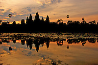 Angkor Wat at sunrise during the Monsoon season, the reflection of the temple in the pond