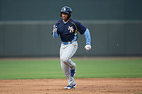 Adonis Paula (16) of the Myrtle Beach Pelicans hustles towards third base against the Winston-Salem Dash at BB&T Ballpark on May 11, 2017 in Winston-Salem, North Carolina.  The Pelicans defeated the Dash 9-7.  (Brian Westerholt/Four Seam Images)
