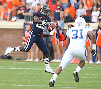 Virginia running back Torrey Mack (25) tries to make a catch in front of Duke linebacker Vincent Rey (31) during an ACC football game Saturday in Charlottesville, VA. Duke won 28-17. Photo/Andrew Shurtleff