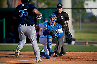 Dunedin Blue Jays catcher Riley Adams (21) looks to tag Reynaldo Rivera (35) as umpire Tanner Dobson looks on to make the call during a Florida State League game against the Lakeland Flying Tigers on April 18, 2019 at Jack Russell Memorial Stadium in Clearwater, Florida.  Dunedin defeated Lakeland 6-2.  (Mike Janes/Four Seam Images)