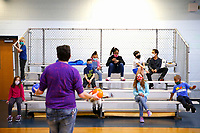 Chance Pendley, Senior Youth Coordinator, teaches kids the rules for a game in the gymnasium at the Boys and Girls Club of Western Pennsylvania in the Lawrenceville neighborhood on Friday February 19, 2021 in Pittsburgh, Pennsylvania. (Photo by Jared Wickerham/Pittsburgh City Paper)