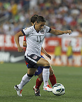Driving USWNT substitute defender Ali Krieger (11). In an international friendly, the U.S. Women's National Team (USWNT) (white/blue) defeated Korea Republic (South Korea) (red/blue), 4-1, at Gillette Stadium on June 15, 2013.