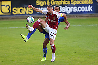 5th September 2020; PTS Academy Stadium, Northampton, East Midlands, England; English Football League Cup, Carabao Cup, Northampton Town versus Cardiff City; Matt Warburton of Northampton Town under pressure from Curtis Nelson of Cardiff City