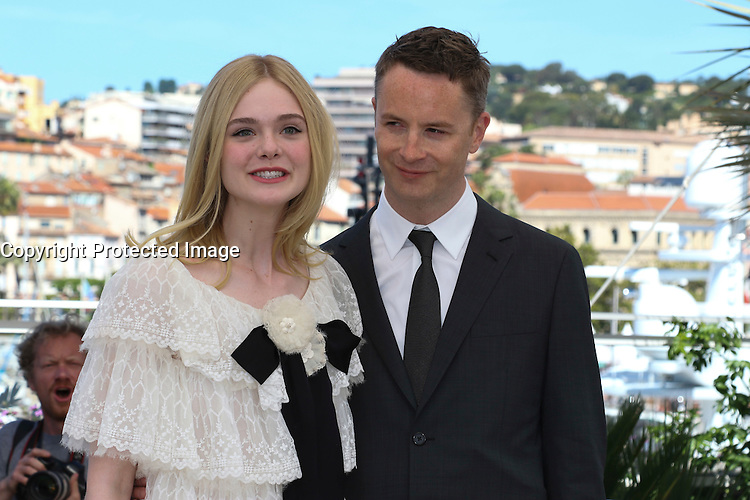 Elle Fanning Nicolas Winding Refn attends 'The Neon Demon' Photocall durig The 69th Annual Cannes Film Festival on May 20, 2016 in Cannes
