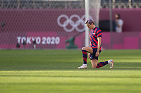 KASHIMA, JAPAN - AUGUST 5: Megan Rapinoe #15 of the United States takes a knee before a game between Australia and USWNT at Kashima Soccer Stadium on August 5, 2021 in Kashima, Japan.