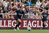 NEWTON, MA - AUGUST 29: Lucy Cappadona #4 of University of Connecticut brings the ball forward during a game between University of Connecticut and Boston College at Newton Campus Soccer Field on August 29, 2021 in Newton, Massachusetts.