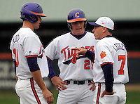 Clemson head coach Jack Leggett talks with two of his players during a time out at a game between the Mercer Bears and Clemson Tigers at Doug Kingsmore Stadium on Feb. 24, 2008, in Clemson, S.C. Clemson won 10-3. Photo by:  Tom Priddy/Four Seam Images